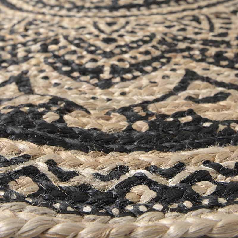 Кръгъл килим от юта с черни шарки