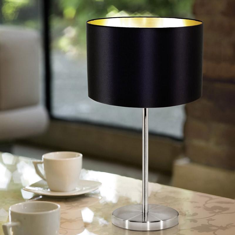Модерна декоративна настолна лампа в цвят черно и златно серия Maserlo