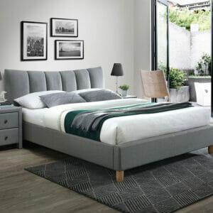 Тапицирано легло в сив цвят на крачета в модерен стил