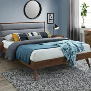 Дървено легло на крачета в цвят орех и сиво в модерен стил.