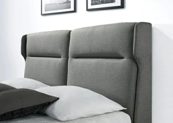 Легло със сива тапицирана табла