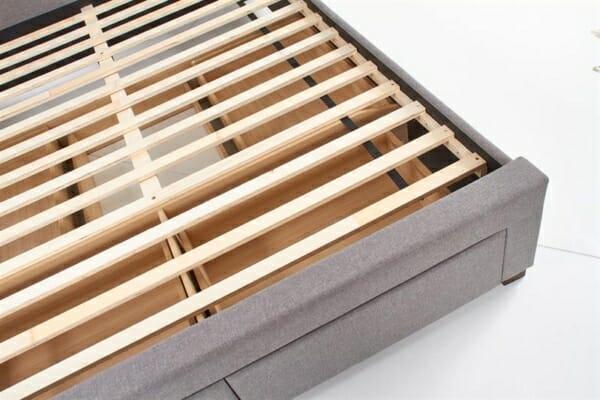 Сиво тапицирано легло с подматрачна рамка