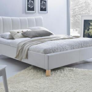 Тапицирано легло в бяла еко кожа на крачета