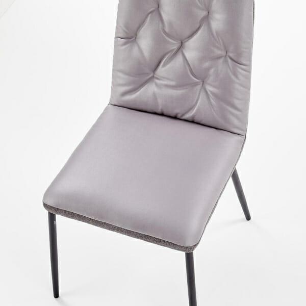 Мек трапезен стол в сиво от еко кожа и текстил-детайл отгоре