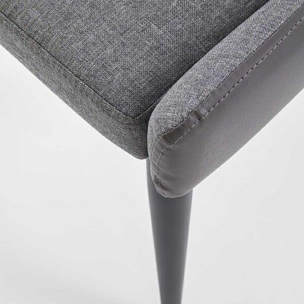 Трапезен стол от текстил и еко кожа в сиво и черно-детайл крак