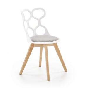 Трапезен стол в бяло и сиво с нестандартна визия