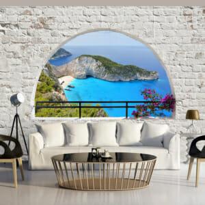 Голям фототапет с бяла тухлена стена и гледка към плаж
