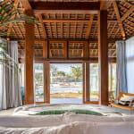 Спалня с дървен таван и френски прозорци